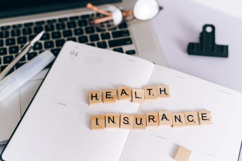 Scrabble tiles spelling out: Health Insurance